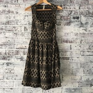 Black and gold/sheer/peekaboo dress